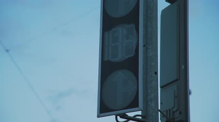 stoplight : Close Up of Traffic Light over Sunset Sky. The Green Streetlight Signal Changing to Red. Transportation and Sign Concept Stock Footage