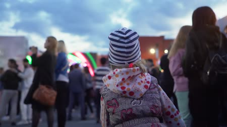 festivais : Novosibirsk, Russian Federation - June 30, 2019: Little Girl Dancing on Street at City Festival in the Evening. People on Streets Celebrating Founded of Novosibirsk City.