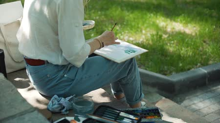 obra prima : Street Artist Paints a Picture with Watercolor. Creative Activity. Still Life of the Artist. Creativity Inspiration Expression Concept Stock Footage