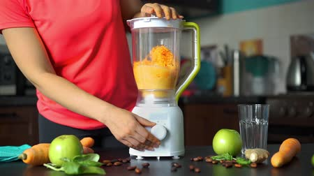 火格子 : Young Woman Blending Carrot and Apples to Make Smoothie in the Kitchen. Slow Motion. Healthy Eating, Cooking, Vegetarian Food and Dieting Concept 動画素材