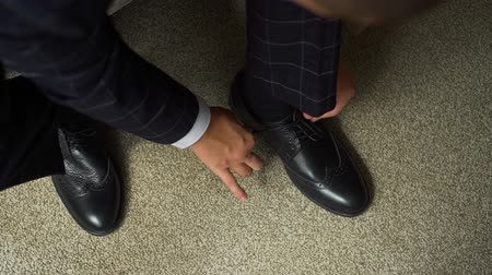 cadarço : Businessman or Groom Tying Shoelaces of his Leather Shoes. Man Dressing Up in Slow Motion