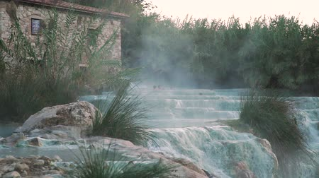 enxofre : Saturnia, Italy - October 8, 2019: Therme di Saturnia - Natural Spa World Famous with Waterfalls and Hot Springs. Thermal Water for Bathing in Tuscany