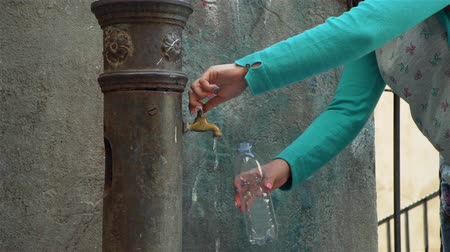 Female Filling Bottle with Fresh Water from Vintage Water Fountain on Italy Street. This Fountains are Popular in Some Italian Cities and People Called them Nasoni. Slow Motion. Concept of Holidays 動画素材