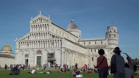 Pisa, Italy - October 10, 2019: Piazza dei Miracoli - World Famous Square in Italy. Unofficial Symbol of City - Tower of Pisa, Known Worldwide for its nearly Four-Degree Lean.
