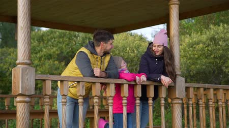 Family of Three Having Holiday in Nature in Autumn Day. Harmony with Nature, Leisure and People Concept