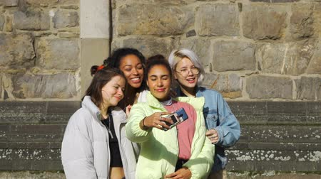 Multiracial Teens Fooling Around while Taking Selfie by Camera of Smartphone on a German Street. People, Leisure, Friendship and Communication concept Wideo