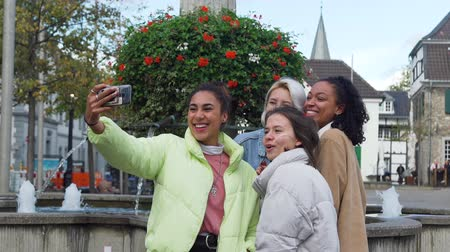 Smiling Female Friends Taking Selfie on a Street of an European City. Group of Mixed Race Girlfriends Having Good Time Outdoors. Slow Motion. Friendship, Lifestyle and People Concept Wideo