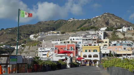csatlakozott : Sant Angelo, Italy - September 28, 2019: View of Sant Angelo Village on Ischia Island. Marvelous Panorama with the Colored Houses Joined to the Hill on the Harbor. Stock mozgókép