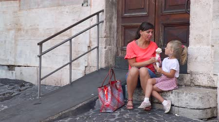 vacations cones : Young Mother and her Cute Daughter Eating Gelato on Vacation Travel in Rome, Italy. Holidays, Travel and Street Food Concept