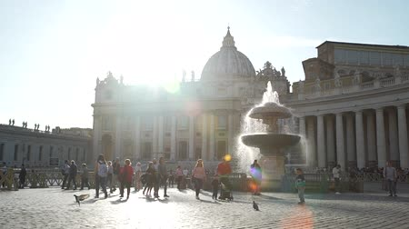roma : Vatican City, Italy - October 6, 2019: Tourist Walking on Beautiful Saint Peter Square in Vatican City at Sunset. Concept of Holidays, Vacations and Travel in Europe