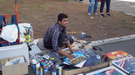 colosseum : Rome, Italy - October 5, 2019: Man Painter Selling Selfmade Pictures of Colosseum in Rome, Italy. Concept of Holidays, Vacations and Travel in Europe Stock Footage
