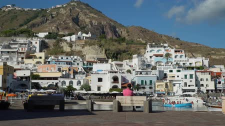 csatlakozott : Sant Angelo, Italy - September 28, 2019: Spectacular Landscape View of Sant Angelo Village on Ischia Island, Italy. Amazing Place with Colored Houses Joined to the Hill in the Tyrrhenian Sea.