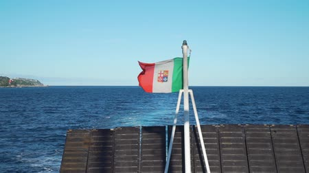 napoli : Italian Flag Waving in the Wind on a Ferry. The Ferry Sailing Farther from the Land. Slow Motion. Concept of Holidays, Vacations and Travel Filmati Stock