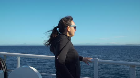 balsa : Young Brunette Woman Enjoying Ferry Ride. Tyrrhenian Sea on the Background. Slow Motion. Concept of Holidays, Vacations and Travel