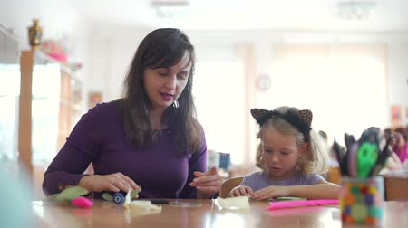 собственность : Little Girl with Mother Engaged in Handcrafts. Creating Artificial Tulip Flowers with their Own Hands. Art, Handmade Crafts and Mothers Day Concept