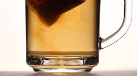 hot beverage : Tea bag in the сup with hot water. Slow motion