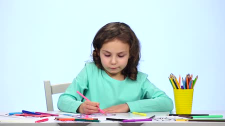 admires : Children paint a picture with pencils and admire their work. Close up. White background Stock Footage