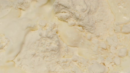 concoction : Milk is poured into handful of wheat flour. Slow motion Stock Footage