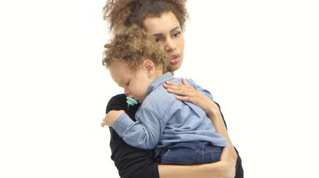 nipple : African american mother is shaking a small child in her arms. White background