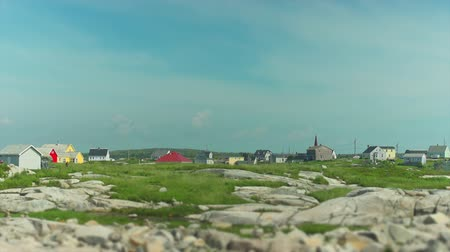 pontozás : Small colourfull houses dotting the rocky shores of Peggys Cove, Nova Scotia. A tilt shift effect has been applied to make the houses appear like miniatures.