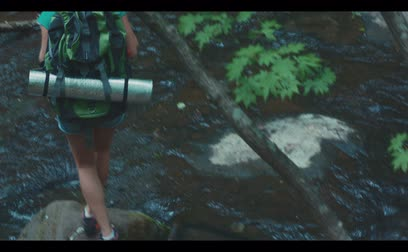 hiking : Hiker woman hiking in forest, stops and looks around. Stock Footage