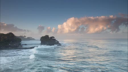 danu : Timelapse of ocean wave with Tanah lot temple in Bali , Indonesia