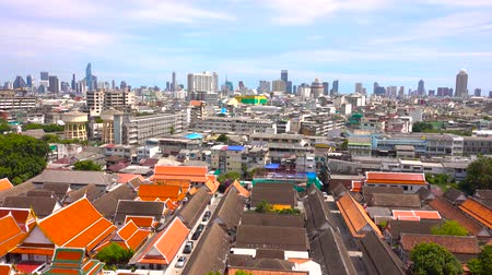montar : City view from The Golden Mount, Wat Saket with building city in Bangkok, Thailand Stock Footage