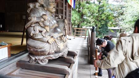 kaminarimon : YAMADERA, JAPAN - OCTOBER 11,2016 : Buddhist of Japanese pilgrimage the god of Shrine in Shrine temple and touch to God statue for lucky.