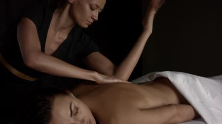 Girl makes a relaxing back massage