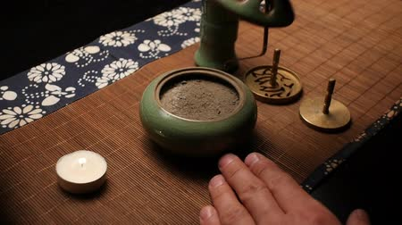 Opening the lid with incense. Chinese tea ceremony