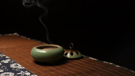 Smoke from incense panorama. Chinese tea ceremony