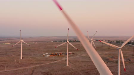 Wind farms at sunset, shooting from a drone