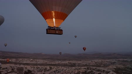 Cappadocia, Turkey. Shooting at dawn, a balloon flies in the sky Stock Footage