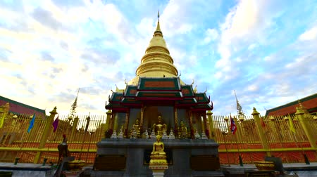 old times : Time lapse video of Phra That Hariphunchai with clouds flowing, Thailand.