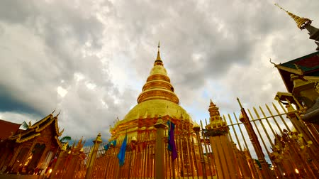 phra : Time lapse video of  Phra That Hariphunchai in the night, Thailand.