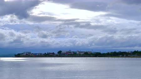 kankalin : 4K time lapse video of Phayao lake with the Phayao city, Thailand.