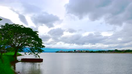 kankalin : 4K time lapse video of Kwan Phayao lake with the Phayao city, Thailand.