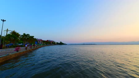 4K time lapse video of walk way with Kwan Phayao lake, Thailand. Stock Footage