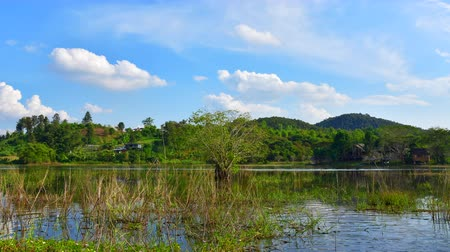 4K time lapse video of mountain and lake with cloud flowing, Thailand. Stock Footage