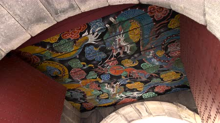wall building feature : Dragon Painting on Ceiling of Seoul Fortress Gwanghuimun at Seoul City, South Korea