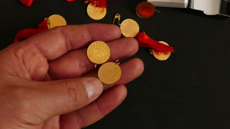 hoard : a man has gold in his hand, Turkish republic quarter gold. Stock Footage