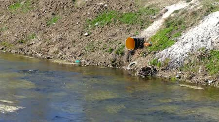drain : stream and sewage wastes flowing through the city