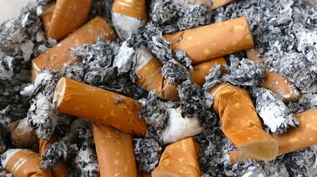 there : There are dozens of cigarette butts in the ashtray,