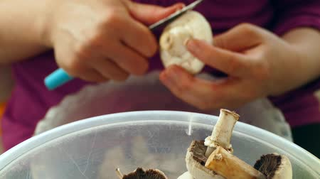 saute : a woman is cutting mushrooms with mushroom knife, prepare mushroom saute.