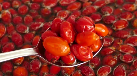 rosehips : make rosehip jam and marmalade, Wash the rosehip fruits in water and mix with spoon,