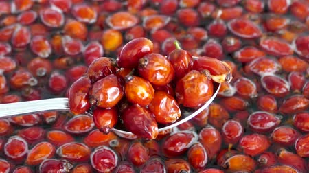 Wash the rosehip fruits in water and mix with spoon.