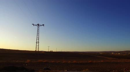 pilon : electric poles perspective image and sunset sky and airplanes