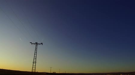 pólos : electric poles perspective image and sunset sky and airplanes