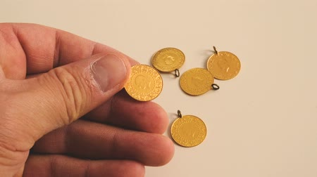 endless gold : Theres gold in the hands of a human, gold coins, gold lira turkey, Stock Footage