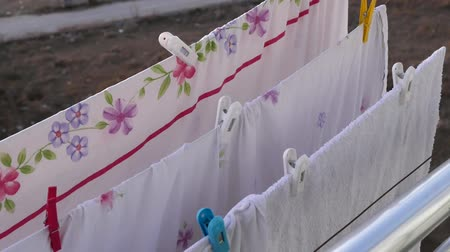 clothesline : drying clothes on the balcony, the balcony is drying bed linens, balcony clothesline and pegs,